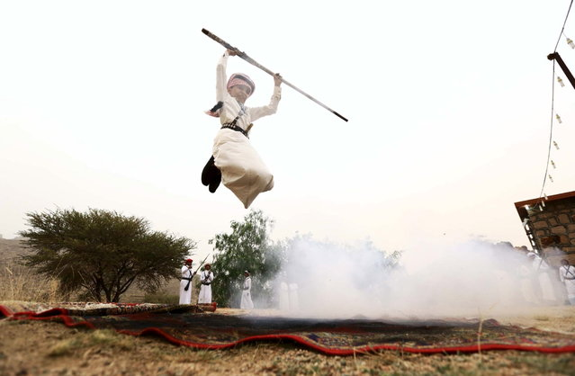 A boy fires a weapon as he dances during a traditional excursion near the western Saudi city of Taif, August 8, 2015. (Photo by Mohamed Al Hwaity/Reuters)