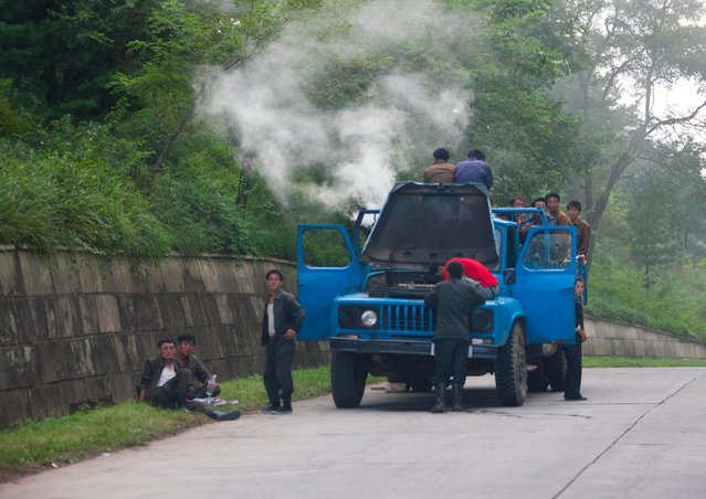 The kind of scene you can see along the highway. Overloaded trucks but broken down with lot of smoke coming out... I was allowed to make those pics as after lunch, my guides were enjoying the confort of the bus seats and snoring... (Photo by Eric Lafforgue/Exclusivepix Media)