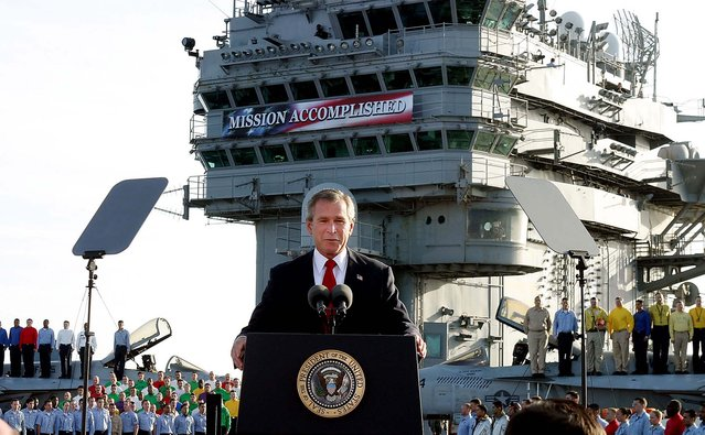 President George W. Bush declares the end of major combat in Iraq as he speaks aboard the aircraft carrier USS Abraham Lincoln off the California coast