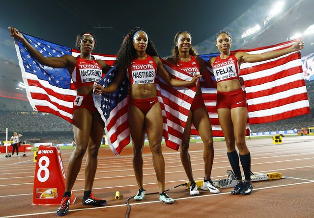 (L-R) Francena McCorory of the U.S. poses with her teammates Natasha Hastings, Sanya Richards-Ross and Allyson Felix after placing second in the women's 4 x 400 metres relay final at the 15th IAAF Championships at the National Stadium in Beijing, China August 30, 2015. (Photo by Kai Pfaffenbach/Reuters)