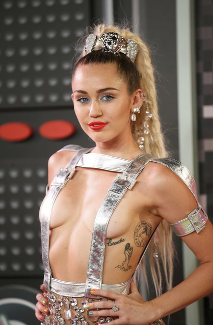 Singer and show host Miley Cyrus arrives at the 2015 MTV Video Music Awards in Los Angeles, California, August 30, 2015. (Photo by Danny Moloshok/Reuters)