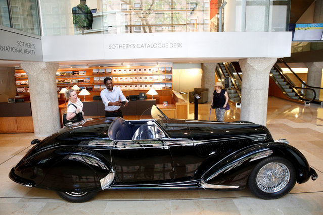 People look at a 1939 Alfa Romeo 8C 2900B Lungo Touring Spider displayed at Sotheby's in New York City, New York, U.S. July 21, 2016. (Photo by Brendan McDermid/Reuters)