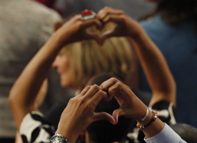 Delegates make heart symbols as the survivors and family members of gun victims speak on the third day of the Democratic National Convention in Philadelphia, Pennsylvania, U.S. July 27, 2016. (Photo by Mike Segar/Reuters)