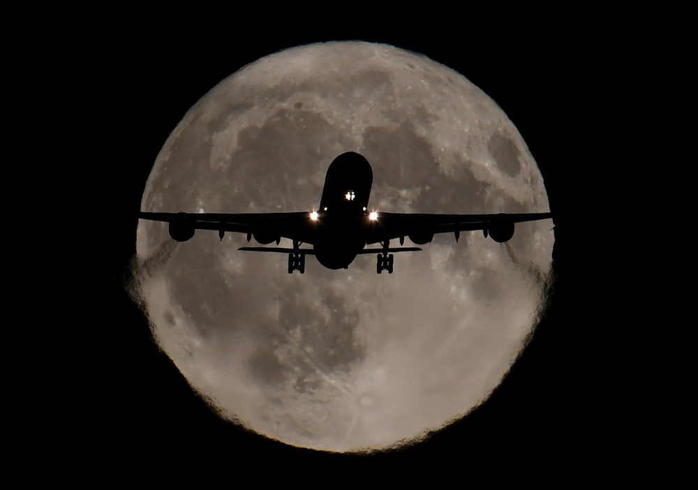 Airplane crossing the Moon