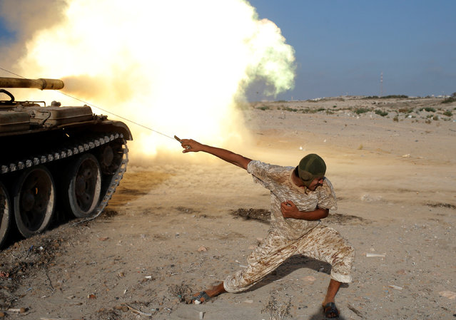 A fighter of Libyan forces allied with the U.N.-backed government fires a shell with Soviet made T-55 tank at Islamic State fighters in Sirte, Libya, August 2, 2016. (Photo by Goran Tomasevic/Reuters)