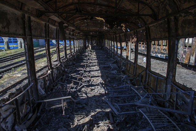 The interior of a burnt-out train is pictured at a railway station in the town of Ilovaysk, eastern Ukraine, September 19, 2014. (Photo by Marko Djurica/Reuters)
