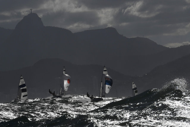Competitors sail in the 470 Women sailing class on Guanabara Bay in Rio de Janerio during the Rio 2016 Olympic Games on August 11, 2016. (Photo by William West/AFP Photo)