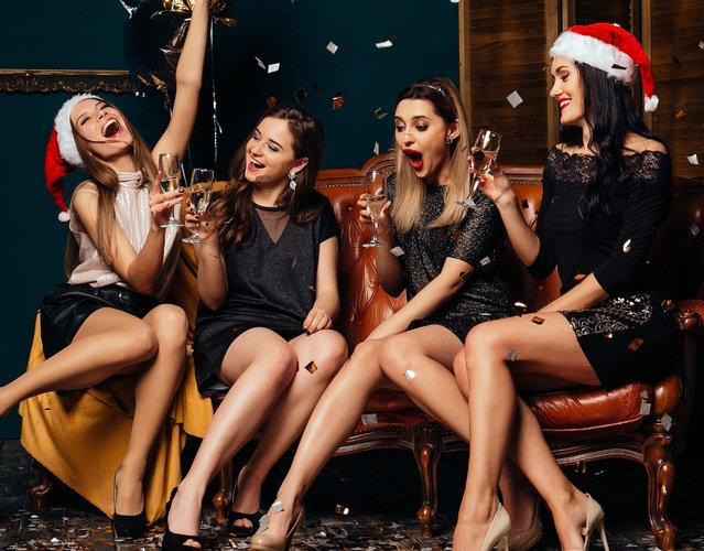 Four glamour women drinking champagne and having fun. Party and Christmas concept. (Photo byazovtcev161/Getty Images)