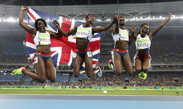 2016 Rio Olympics, Athletics, Final, Women's 4 x 100m Relay Final, Olympic Stadium, Rio de Janeiro, Brazil on August 19, 2016. Darryl Neita (GBR) of Britain, Asha Philip (GBR) of Britain, Desiree Henry (GBR) of Britain, Dina Asher-Smith (GBR) of Britain celebrate. (Photo by Phil Noble/Reuters)