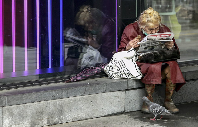 A Bosnian woman wearing a face mask reads a newspaper amid the ongoing coronavirus and COVID-19 disease pandemic in Sarajevo, Bosnia and Herzegovina, 20 May 2020. Countries around the world are taking increased measures to stem the spread of the SARS-CoV-2 coronavirus which causes the COVID-19 disease. (Photo by Fehim Demir/EPA/EFE/Rex Features/Shutterstock)