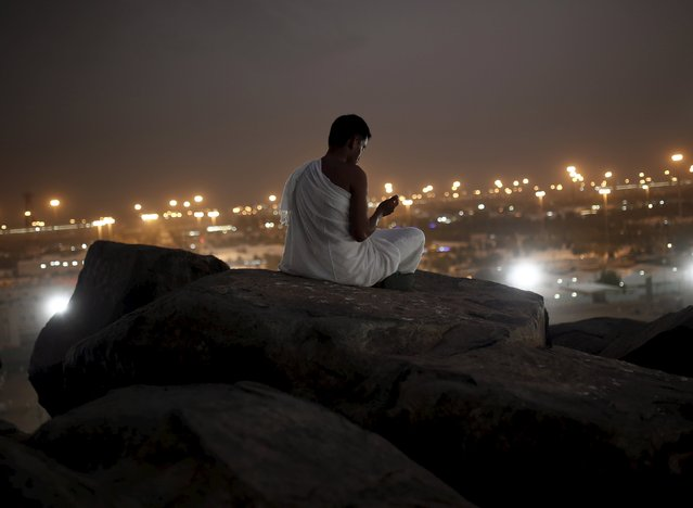 Muslim pilgrims pray on Mount Mercy on the plains of Arafat during the annual haj pilgrimage, outside the holy city of Mecca September 22, 2015. (Photo by Ahmad Masood/Reuters)