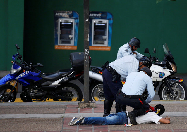 Police officers detain a protester during a rally to demand a referendum to remove Venezuela's President Nicolas Maduro in Caracas, Venezuela, September 1, 2016. (Photo by Carlos Garcia Rawlins/Reuters)