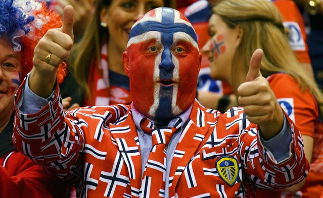 A supporter of Norway cheers up his team during the IHF Womens World Championship handball final match between France and Norway on December 17, 2017 in Hamburg, nothern Germany. (Photo by Patrik Stollarz/AFP Photo)
