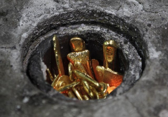 Scrap pieces of gold are placed into a furnace to be melted down at the Emirates Gold refinery in Dubai, United Arab Emirates. (Photo by Kamran Jebreili/AP Photo)