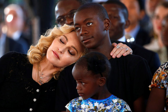Madonna embraces her son David Banda ahead of the opening of the Mercy James hospital in Blantyre, Malawi, July 11, 2017. (Photo by Siphiwe Sibeko/Reuters)