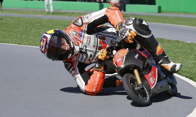Jack Miller of Australia steers a mini electric motorcycle during a fan event at the Twin Ring Motegi circuit ahead of Sunday's MotoGP Japanese Motorcycle Grand Prix in Motegi, north of Tokyo, Thursday, October 8, 2015. (Photo by Shizuo Kambayashi/AP Photo)