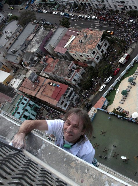 "Alain Robert of France, who is known as ""Spiderman"", climbs the Habana Libre hotel in Havana February 4, 2013. Robert, who scales buildings all over the world without safety equipment, successfully climbed the hotel which is 126 metres (413 feet) high.  REUTERS/Stringer (CUBA - Tags: SOCIETY)"