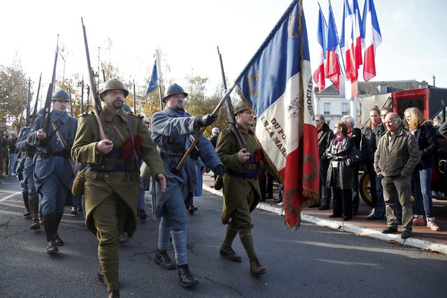 """History enthusiasts of French association """"Le Poilu de la Marne"""" parade during an Armistice Day ceremony to commemorate the end of World War One at Epernay, eastern France, November 11, 2014. (Photo by Charles Platiau/Reuters)"""