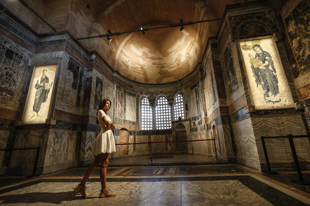 A woman visits St Savior in Chora church, known as Kariye in Turkish, in Istanbul, Friday, August 21, 2020. Turkey on Friday formally converted former Byzantine church, St Savior in Chora, into a mosque, a month after it similarly turned Istanbul's landmark Hagia Sophia into a Muslim house of prayer, drawing international rebuke. (Photo by Emrah Gurel/AP Photo)