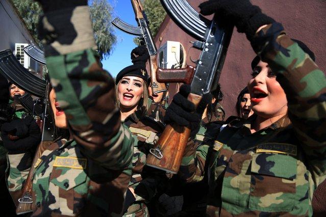 Female Peshmerga officers celebrate after their graduation ceremony, at Zakho military academy in Zakho town, Dohuk, Kurdistan Region in Iraq, 30 January 2018. The graduation ceremony was for 418 male and female Peshmerga fighters. (Photo by Gailan Haji/EPA/EFE)