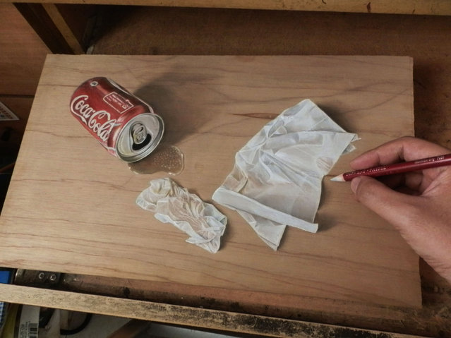 Ivan Hoos drawing of a knocked over Coke can. (Photo by Ivan Hoo/Caters News)
