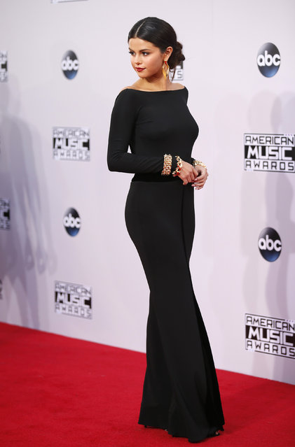Selena Gomez arrives at the 42nd American Music Awards in Los Angeles. (Photo by Danny Moloshok/Reuters)