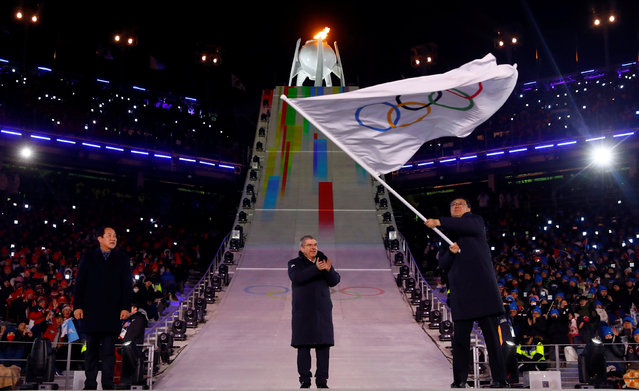 Beijing mayor Chen Jining waves the Olympic flag during the closing ceremony of the PyeongChang Winter Olympic Games at the Olympic Stadium in Pyeongchang, South Korea, on February 25, 2018. (Photo by Kai Pfaffenbach/Reuters)