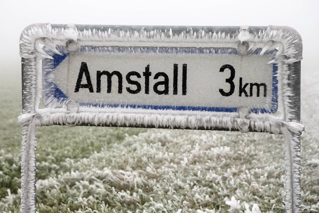 An ice covered road sign is pictured near Amstall in northern Austria, December 2, 2014. (Photo by Heinz-Peter Bader/Reuters)