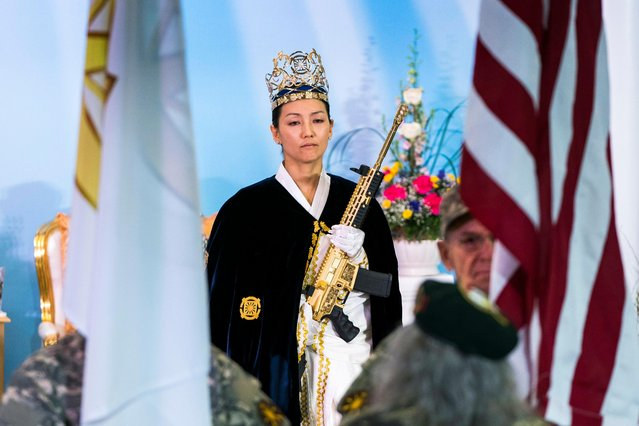 Rev. Yeon Ah Lee Moon of the Sanctuary Church holds a gold AR-15 during a ceremony to rededicate marriages at the World Peace and Unification Sanctuary in Newfoundland, Pennsylvania, USA, 28 February 2018. (Photo by Jim Lo Scalzo/EPA/EFE)