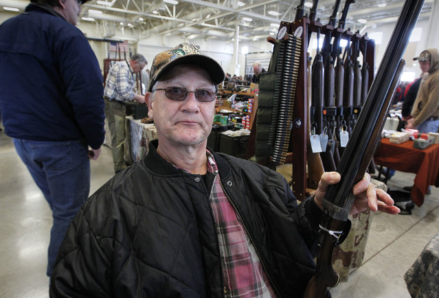 Robert Repinski, of Plover, brought a friends 20 gauge shotgun to try and sell at the Washington County Fairgrounds Gun Show that drew thousands of people over the weekend, on March 22, 2013. (Photo by Gary Porter)