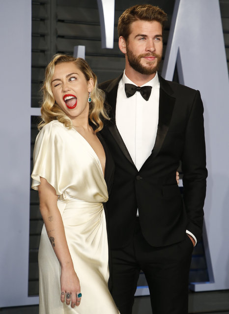 Miley Cyrus and Liam Hemsworth attend the 2018 Vanity Fair Oscar Party hosted by Radhika Jones at the Wallis Annenberg Center for the Performing Arts on March 4, 2018 in Beverly Hills, California. (Photo by Danny Moloshok/Reuters)