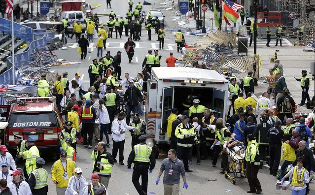 Medical workers aid those injured at the finish line of the 2013 Boston Marathon. (Photo by Charles Krupa/Associated Press)