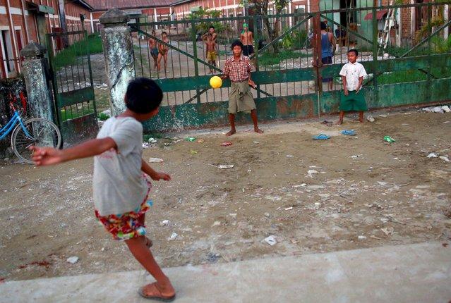 Boys play soccer in Yangon, Myanmar on  October 22, 2015. (Photo by Soe Zeya Tun/Reuters)