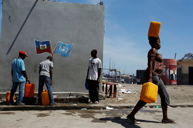 People collect water from a water well after Hurricane Matthew passes in Jeremie, Haiti, October 8, 2016. (Photo by Carlos Garcia Rawlins/Reuters)