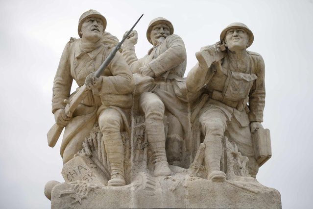 A sculpture representing three World War I soldiers in an attack position is seen on top of the Navarin monument, a pyramid inaugurated at Sommepy-Tahure in 1924 to pay tribute to World War I soldiers killed in Champagne, eastern France, November 3, 2015. (Photo by Charles Platiau/Reuters)