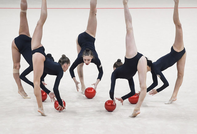 Azerbaijan's team competes in the 5 balls program event during the 36th European Rhythmic Gymnastics Championships in Kiev, on November 26, 2020. (Photo by Sergei Supinsky/AFP Photo)