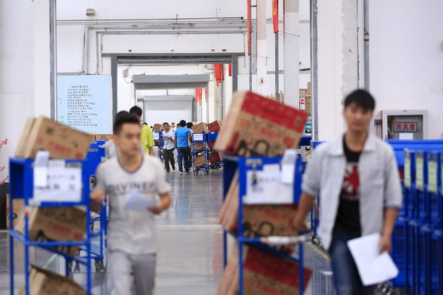 Employees work at a Tmall logistic centre in Suzhou, Jiangsu province, China, October 28, 2015. (Photo by Jason Lee/Reuters)