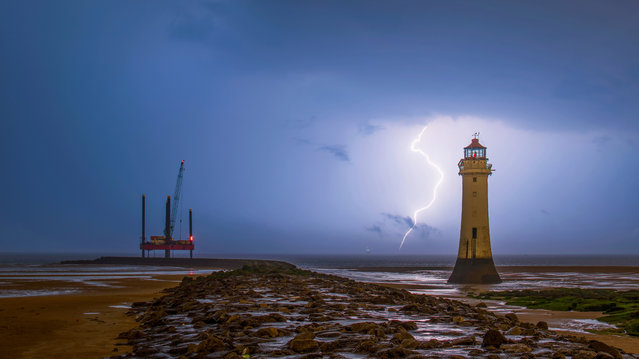 Lightning at Perch Rock Lighthouse in Merseyside, North West England on August 10, 2020. (Photo by Bav Media/The Sun)