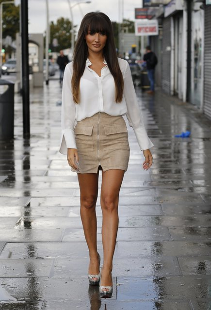Megan McKenna arrive for filming their reality series at Faces nightclub in Gants Hill, Essex, England on October 16, 2016. It was raining down as the cast members arrived but that didn't stop them from smiling and posing for the cameras. (Photo by FameFlynet UK)