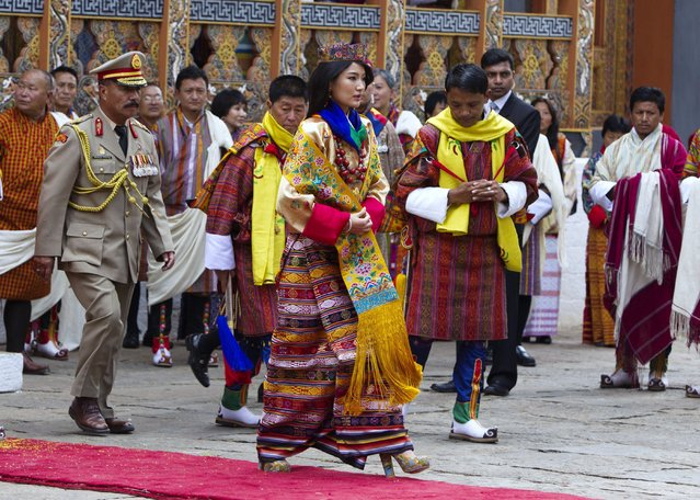 Queen Ashi Jetsun Pema, 21, walks out after the marriage ceremony is completed on October 13, 2011 in Punakha, Bhutan. The Dzong is the same venue that hosted the King's historic coronation ceremony in 2008. The Oxford-educated king is popular in the country and the ceremony will be followed by celebration in the capital and countryside. (Photo by Paula Bronstein/Getty Images)