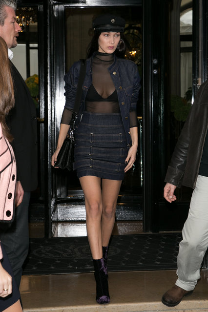 """Model Bella Hadid leaves the """"L'Avenue"""" restaurant on October 28, 2016 in Paris, France. (Photo by Marc Piasecki/GC Images)"""