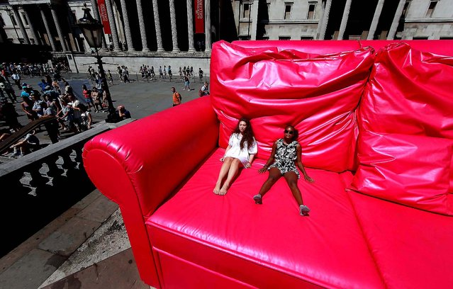 Two girls enjoy the sunshine from a giant pink sofa before the start of the finale of the T-Mobile Big Dance 2010 in Trafalgar Square in London. (Photo by Peter Macdiarmid/Getty Images)