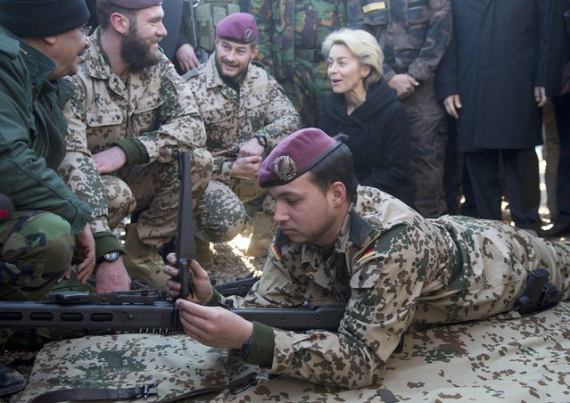 German Defence Minister Ursula von der Leyen (background R) visits the Zeravani Training Centre in Bnaslava near Arbil, north of Iraq January 12, 2015, where Kurdish forces are being trained by the German army, Bundeswehr. (Photo by Maurizio Gambarini/Reuters)