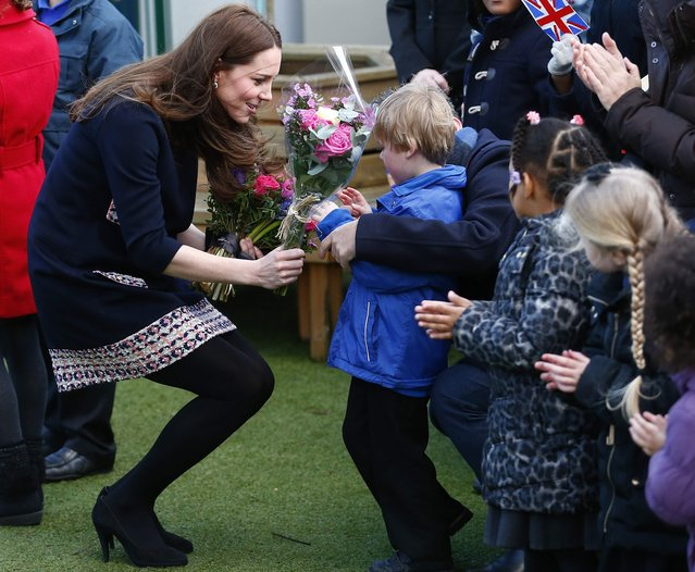 Britain's Catherine, Duchess of Cambridge receives a bouquet of flowers as she leaves after visiting the Clore Art Room in west London January 15, 2015. (Photo by Andrew Winning/Reuters)