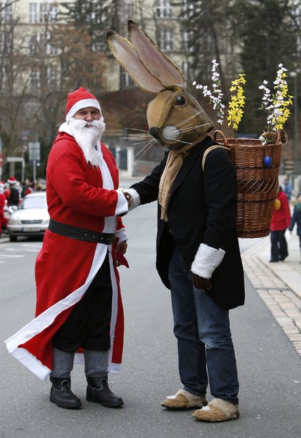 A man dressed as Santa Claus wecomes another dressed as the Easter Bunny during the 22nd Santa Claus meeting in Auerbach, Germany, December 6, 2015. (Photo by Michaela Rehle/Reuters)