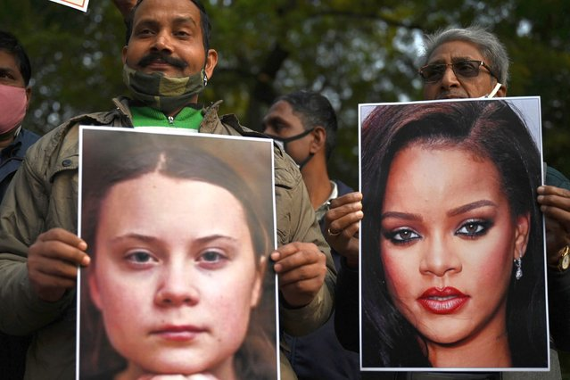 Activists of United Hindu Front (UHF) hold pictures of Swedish climate activist Greta Thunberg and Barbadian singer Rihanna during a demonstration in New Delhi on February 4, 2021, after they made comments on social media about mass farmers' protests in India. (Photo by Money Sharma/AFP Photo)