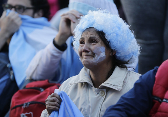Argentine fans react in disbelief at the end of a televised broadcast of the Croatia vs Argentina World Cup soccer match, in Buenos Aires, Argentina, Thursday, June 21, 2018. Argentina lost 3-0 to Croatia. (Photo by Jorge Saenz/AP Photo)