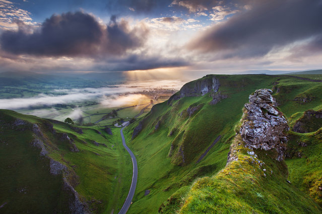 "Undated handout issued by Take A View of Sunrise at Winnats Pass, Derbyshire, England which won the Visit Britian ""You're invited"" Award for the best image from an overseas entrant category in this year's Landscape Photographer of the Year Awards. (Photo by Sven Mueller/PA Wire)"