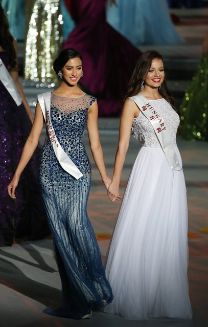 Contestants Miss Honduras, Gabriela Vanessa Salazar Valle (L) and Miss Hungary, Daniella Kiss walk on stage during the grand final of the 65th Miss World pageant at the Beauty Crown Hotel Complex in Sanya, Hainan province, China, 19 December 2015. (Photo by How Hwee Young/EPA)