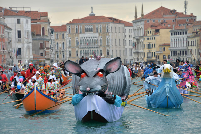 People in costumes participating in a water parade, sail in gondola along the Grand Canal to the Cannaregio district during the Venice Carnival, in Venice, northern Italy, February 1, 2015. The traditional parade officially opened the carnival. (Photo by Andrea Merola/EPA)